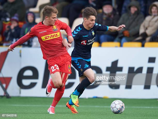 Mathias Jensen of FC Nordsjalland and Gregor Sikosek of Brondby IF compete for the ball during the Danish Alka Superliga match between FC...