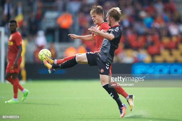 Mathias Jensen of FC Nordsjalland and Jannik Pohl of AaB Aalborg compete for the ball during the Danish Alka Superliga match between FC Nordsjalland...
