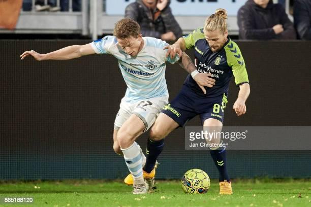 Mathias Johannsen of FC Helsingor and Kasper Fisker of Brondby IF compete for the ball during the Danish Alka Superliga match between FC Helsingor...