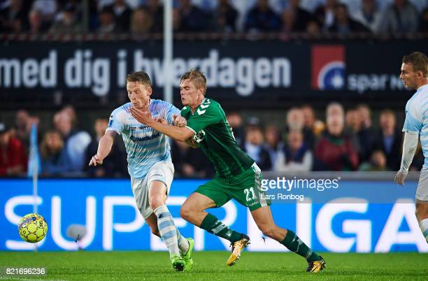 Mathias Johannsen of FC Helsingor and Mathias Greve of OB Odense compete for the ball during the Danish Alka Superliga match between FC Helsingor and...