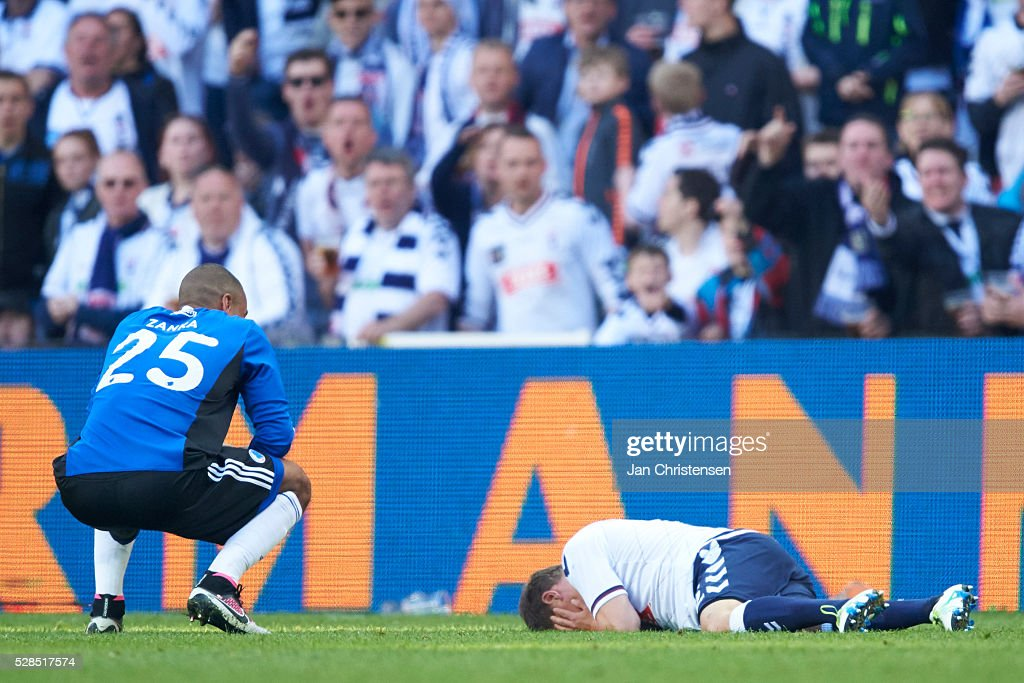 Mathias Jorgensen of FC Copenhagen near Daniel Christensen of AGF Arhus who gets injuried during the DBU Pokalen Cup Final match between AGF Arhus and FC Copenhagen at Telia Parken Stadium on May 05, 2016 in Copenhagen, Denmark.