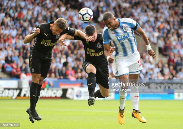 Mathias Jorgensen of Huddersfield Town Dwight Gayle of Newcastle United and Ciaran Clark of Newcastle United all battle to win a header during the...