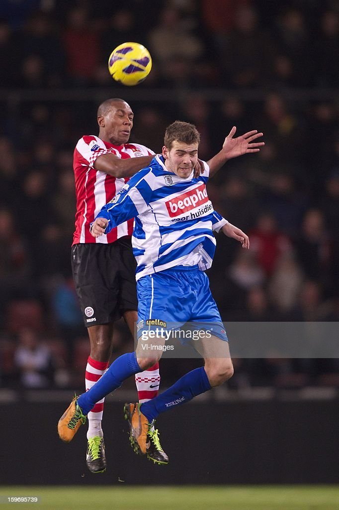 Mathias Jorgensen of PSV, Wiljan Pluim of PEC Zwolle during the Dutch Eredivise match between PSV and PEC Zwolle at the Philips Stadium on January 18, 2013 in Eindhoven, The Netherlands.