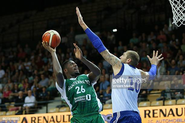 Mathias Lessort of Nanterre and Dmitry Sokolov of Khimki Moscow during the match for the 3rd and 4th place between Nanterre and Khimki Moscow at...