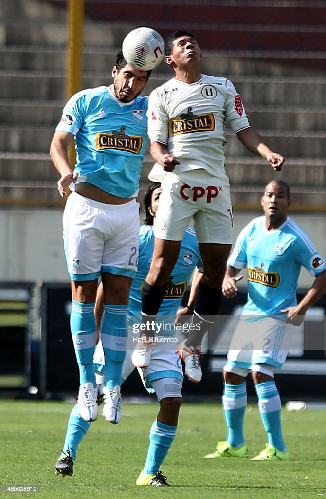 Mathias Martinez (L) of Sporting Cristal struggles for the ball with <a gi-track='captionPersonalityLinkClicked' href=/galleries/search?phrase=Edison+Flores&family=editorial&specificpeople=8597891 ng-click='$event.stopPropagation()'>Edison Flores</a> (R) of Universitario during a match between Universitario and Sporting Cristal as part of 17th round of Torneo Apertura 2015 at Monumental Stadium on August 23, 2015 in Lima, Peru.