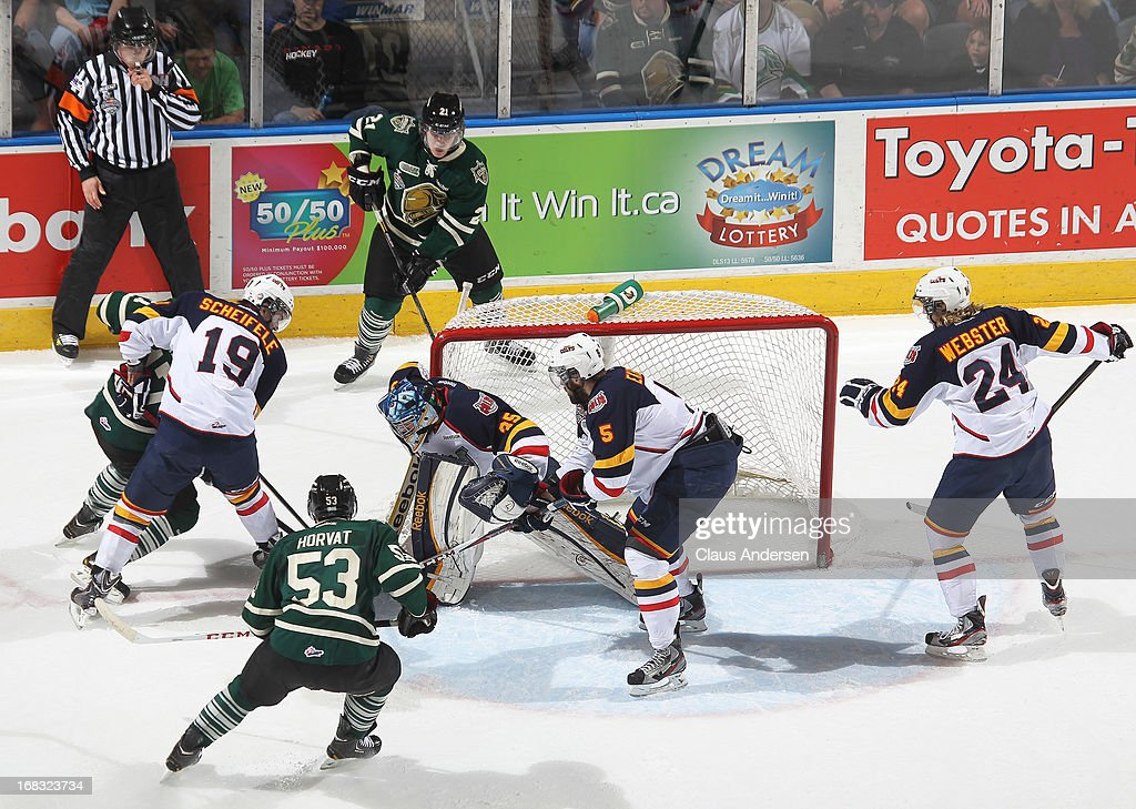 Mathias Niederberger #35 of the Barrie Colts covers the corner in Game One of the OHL Championship Final against the London Knights on May 3, 2013 at the Budweiser Gardens in London, Ontario, Canada. The Colts defeated the Knights 4-2 to take a 1-0 series lead.