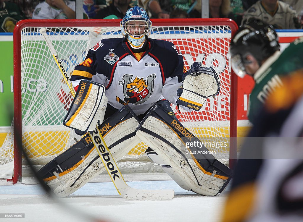 Mathias Niederberger #35 of the Barrie Colts gets set to face a shot in Game One of the OHL Championship Final against the London Knights on May 3, 2013 at the Budweiser Gardens in London, Ontario, Canada. The Colts defeated the Knights 4-2 to take a 1-0 series lead.