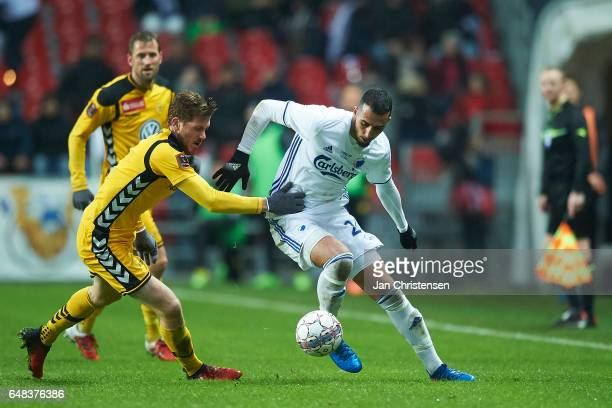 Mathias Nielsen of AC Horsens and Youssef Toutouh of FC Copenhagen compete for the ball during the Danish Alka Superliga match between FC Copenhagen...