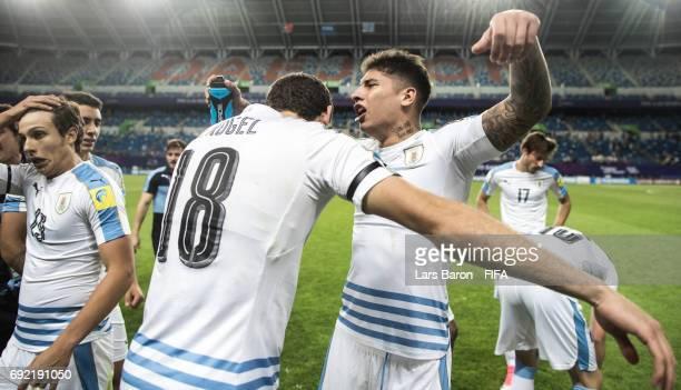 Mathias Olivera of Uruguay celebrates with Agustin Rogel of Uruguay after winning the FIFA U20 World Cup Korea Republic 2017 Quarter Final match...
