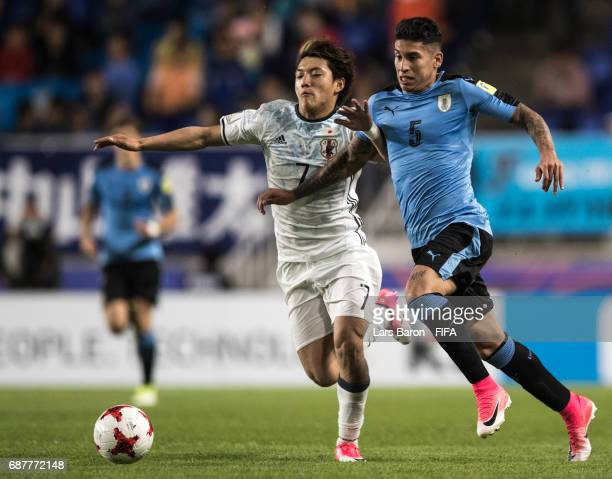 Mathias Olivera of Uruguay is challenged by Ritsu Doan of Japan during the FIFA U20 World Cup Korea Republic 2017 group D match between Uruguay and...