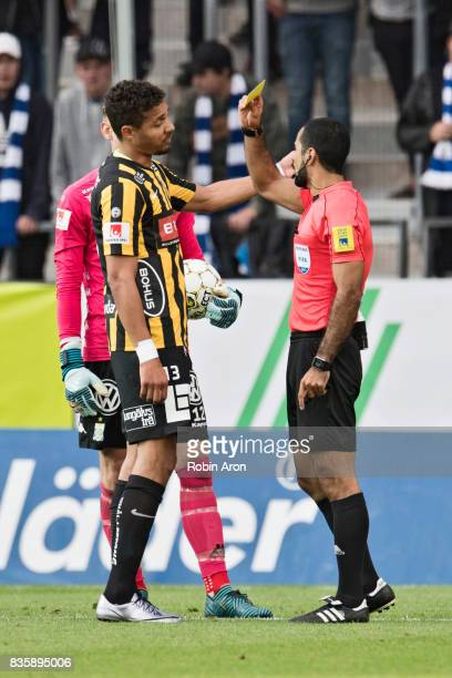 Mathias Ranegie of IFK Goteborg receives a yellow card from referee Mohammed AlHakim during the Allsvenskan match between IFK Goteborg and BK Hacken...