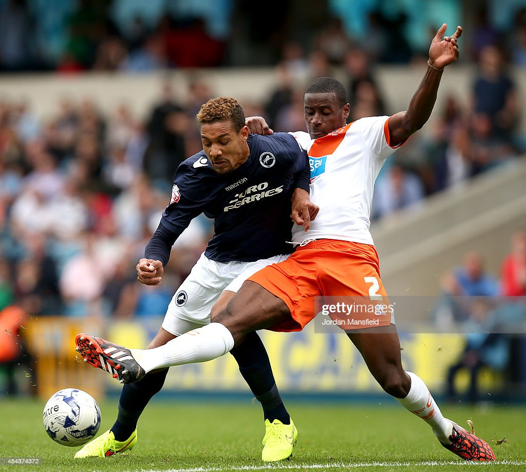 <a gi-track='captionPersonalityLinkClicked' href=/galleries/search?phrase=Mathias+Ranegie&family=editorial&specificpeople=8283787 ng-click='$event.stopPropagation()'>Mathias Ranegie</a> of Millwall tackles with Donervon Daniels of Blackpool during the Sky Bet Championship match between Millwall and Blackpool at The Den on August 30, 2014 in London, England.