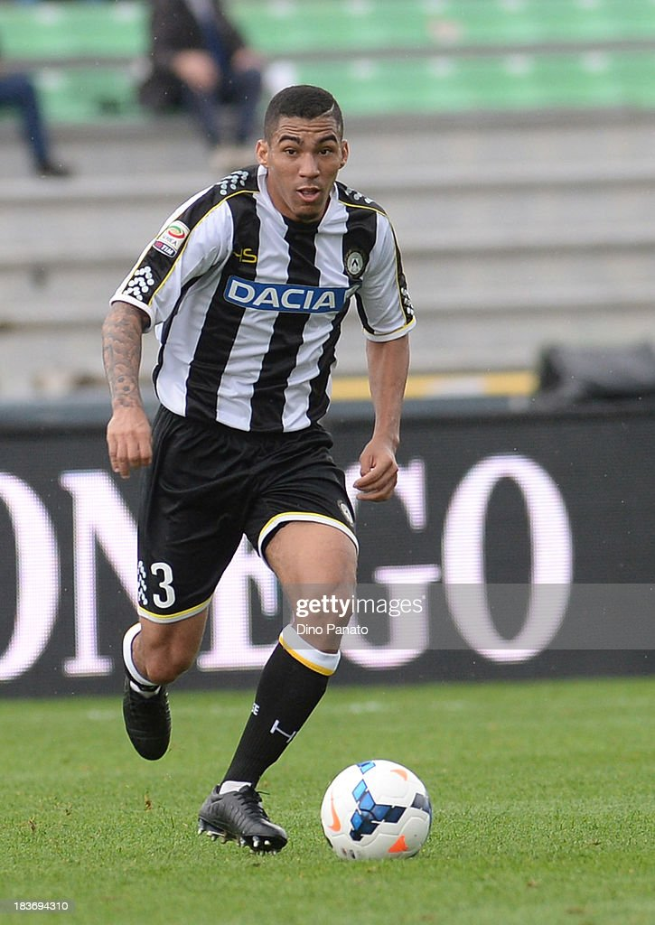 <a gi-track='captionPersonalityLinkClicked' href=/galleries/search?phrase=Mathias+Ranegie&family=editorial&specificpeople=8283787 ng-click='$event.stopPropagation()'>Mathias Ranegie</a> of Udinese Calcio in action during the Serie A match between Udinese Calcio and Cagliari Calcio at Stadio Friuli on October 6, 2013 in Udine, Italy.