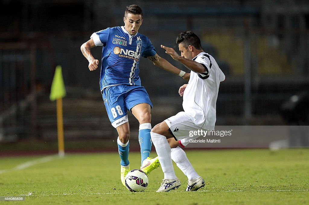 Mathias Vecino of Empoli Fc battles for the ball with Lorenzo Del Pinto of L'Aquila Calcio during the TIM Cup match between Empoli FC and L'Aquila Calcio at Stadio Carlo Castellani on August 24, 2014 in Empoli, Italy.