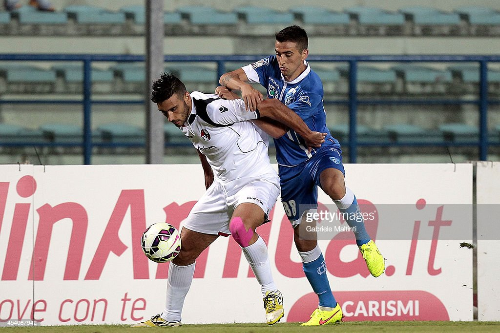 Mathias Vecino of Empoli FC evades Giordano Maccarrone of L'Aquila Calcio during during the TIM Cup match between Empoli FC and L'Aquila Calcio at Stadio Carlo Castellani on August 24, 2014 in Empoli, Italy.
