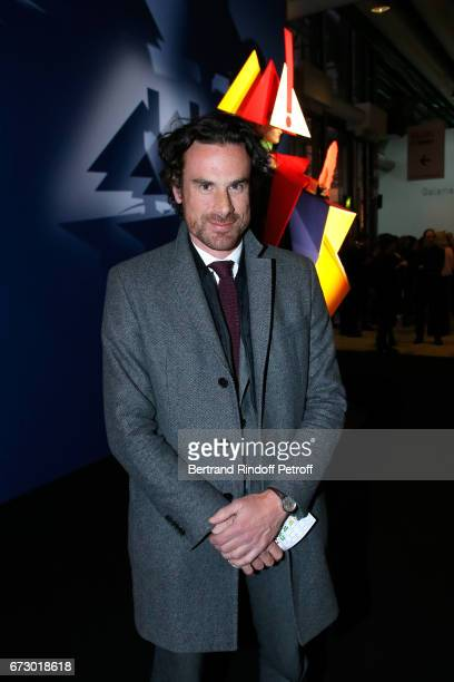 Mathias Vicherat poses in front the works of JeanPaul Goude during the 'Societe des Amis du Musee d'Art Moderne du Centre Pompidou' Dinner Party Held...