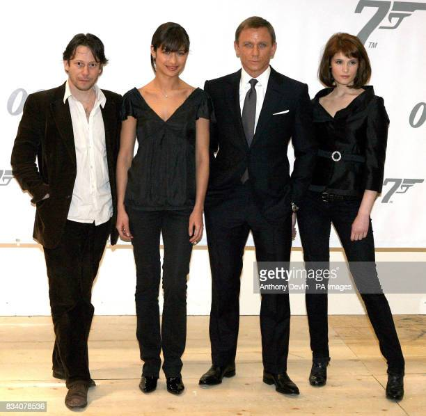 Mathieu Amalric Olga Kurylenko Daniel Craig and Gemma Arterton pose for the media during a photocall to promote the new James Bond movie Quantum of...