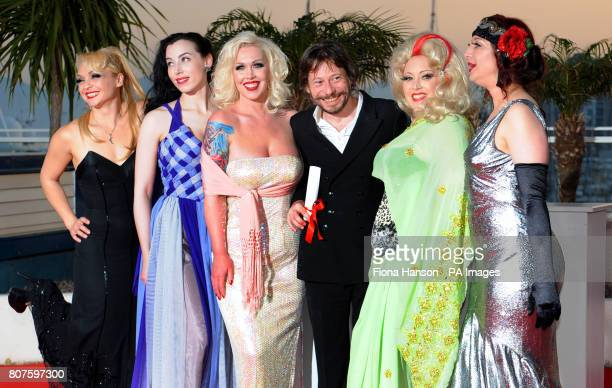 Mathieu Amalric with the stars of his film On Tour for which he won the Best Director Award at the 63rd Cannes Film Festival France