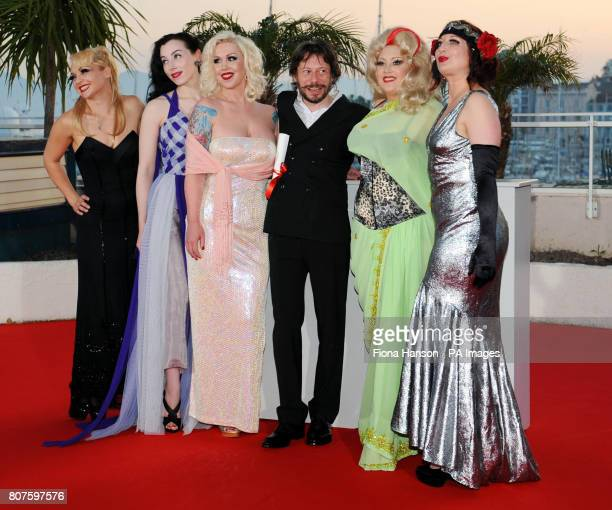 Mathieu Amalric with the stars of his film On Tour for which he won the Palme d'Or for Best Director at the 63rd Cannes Film Festival France