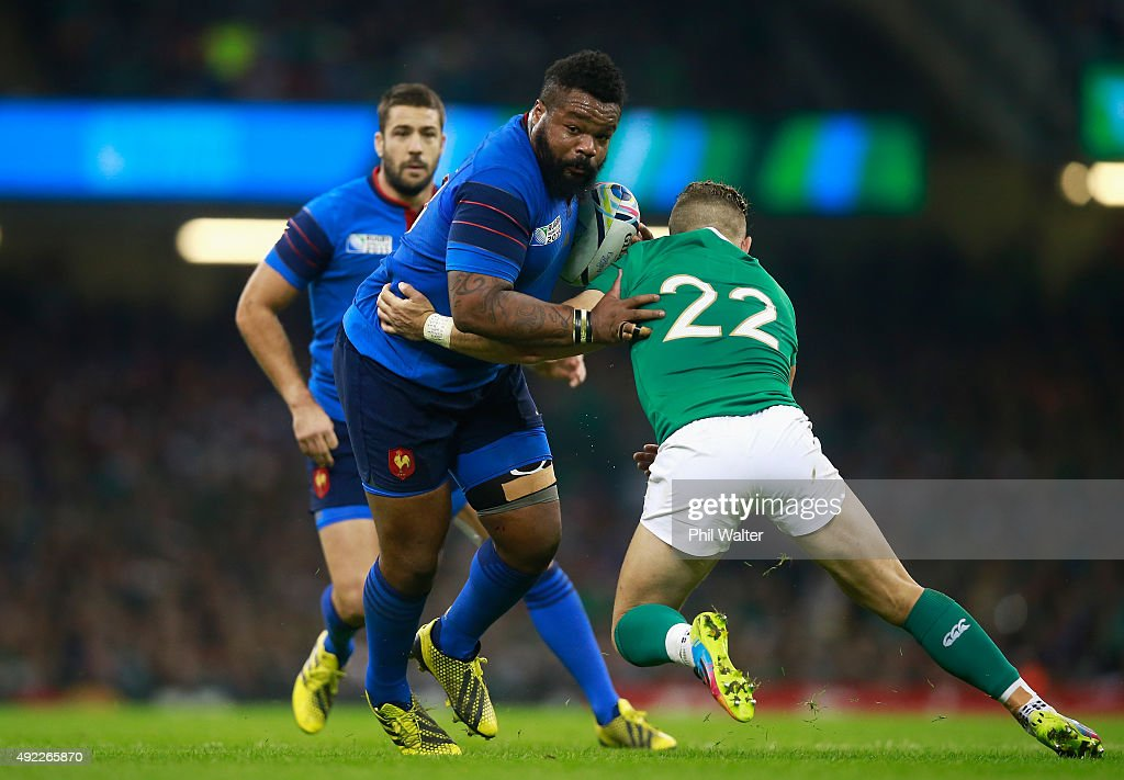 <a gi-track='captionPersonalityLinkClicked' href=/galleries/search?phrase=Mathieu+Bastareaud&family=editorial&specificpeople=677501 ng-click='$event.stopPropagation()'>Mathieu Bastareaud</a> of France is tackled by <a gi-track='captionPersonalityLinkClicked' href=/galleries/search?phrase=Ian+Madigan&family=editorial&specificpeople=5409474 ng-click='$event.stopPropagation()'>Ian Madigan</a> of Ireland during the 2015 Rugby World Cup Pool D match between France and Ireland at Millennium Stadium on October 11, 2015 in Cardiff, United Kingdom.