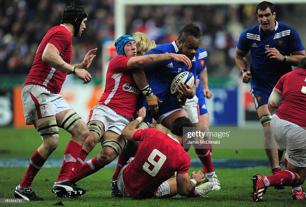 Mathieu Bastareaud of France is tackled by Justin Tipuric of Wales during the RBS Six Nations match between France and Wales at Stade de France on February 9, 2013 in Paris, France.