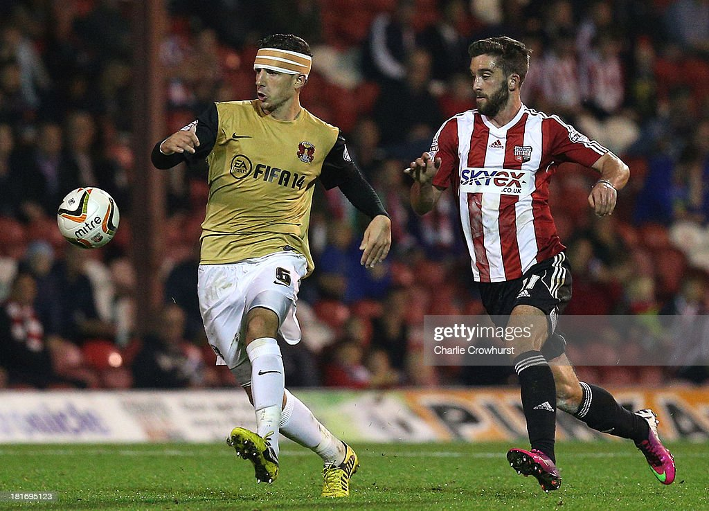 Mathieu Baudry of Orient gets away from Brentford's Will Grigg during the Sky Bet League Once match between Brentford and Leyton Orient at Griffin Park on September 23, 2013 in Brentford, England.