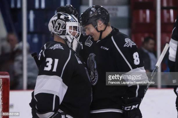 Mathieu Bellemare and PierOlivier Lacombe of the Gatineau Olympiques celebrate their 7 1 victory against the Shawinigan Cataractes on October 6 2017...