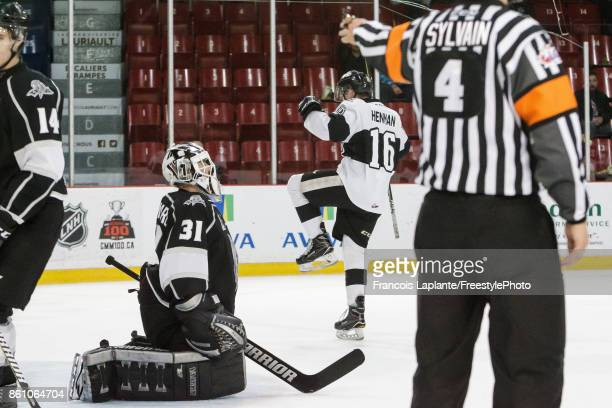 Mathieu Bellemare of the Gatineau Olympiques looks on as Luke Henman of the BlainvilleBoisbriand Armada celebrates his third period game winning goal...