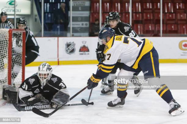 Mathieu Bellemare of the Gatineau Olympiques makes a save against Vasily Glotov of the Shawinigan Cataractes on October 6 2017 at Robert Guertin...