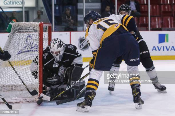 Mathieu Bellemare of the Gatineau Olympiques makes a save against Gabriel Denis of the Shawinigan Cataractes on October 6 2017 at Robert Guertin...