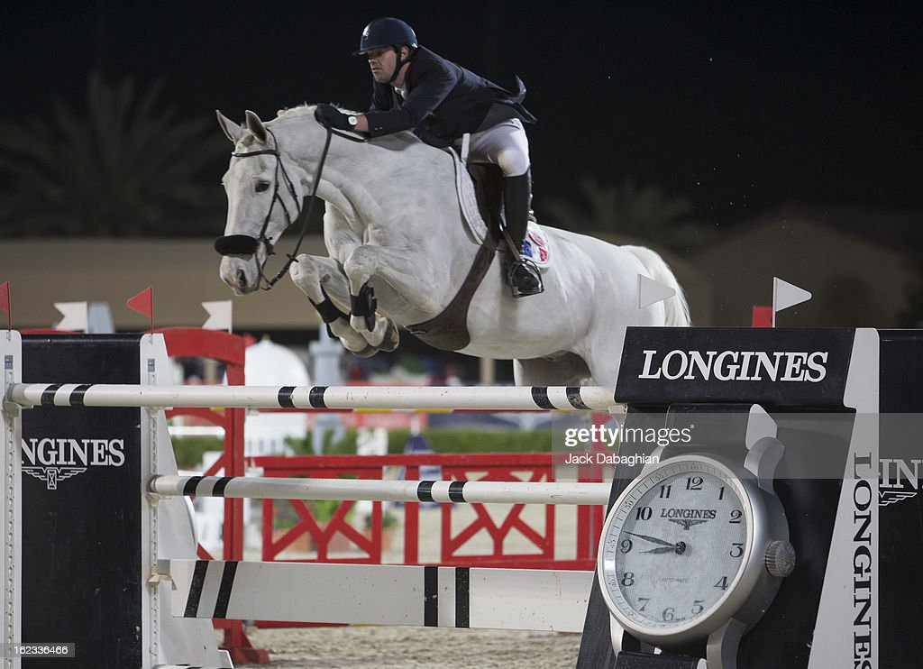 Mathieu Billot of France clears a hurdle on Pardoes during the President of the UAE Showjumping Cup - Furusyiah Nations Cup Series presented by Longines on February 21, 2013 in Al Ain, United Arab Emirates.