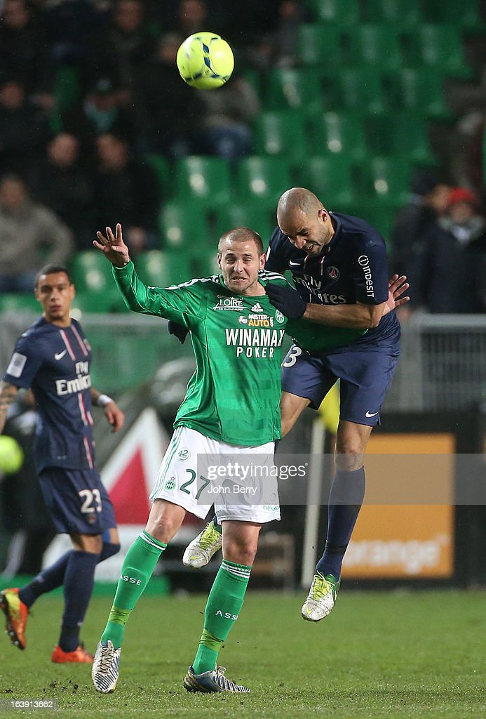 Mathieu Bodmer of Saint-Etienne and Alex Dias Da Costa of PSG in action during the Ligue 1 match between AS Saint-Etienne ASSE and Paris Saint-Germain FC at the Stade Geoffroy-Guichard on March 17, 2013 in Saint-Etienne, France.
