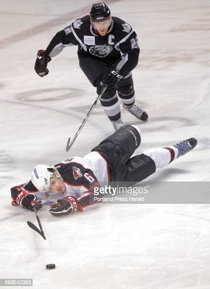 Mathieu Brodeur of the Pirates hits the ice while trying to advance the puck down the ice during a game against the Manchester Monarchs at the...