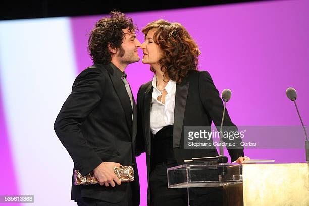 Mathieu Chedid with his Cesar award for 'Best Music' and host Valerie Lemercier on stage at the Cesar 2007 ceremony