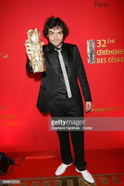 Mathieu Chedid with his Cesar award for 'Best Music' arrives at the post Cesar award ceremony dinner at Fouquet's in Paris