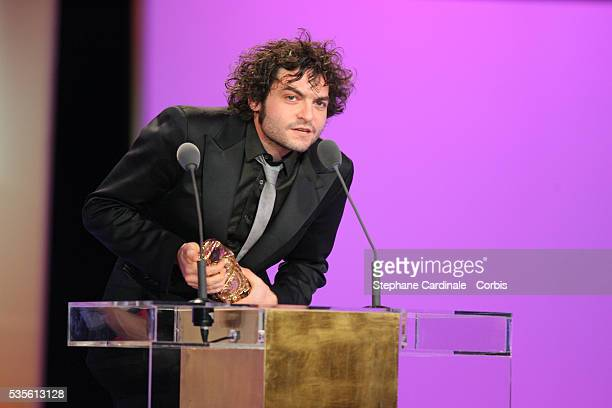 Mathieu Chedid with his Cesar award for 'Best Music' on stage at the Cesar 2007 ceremony