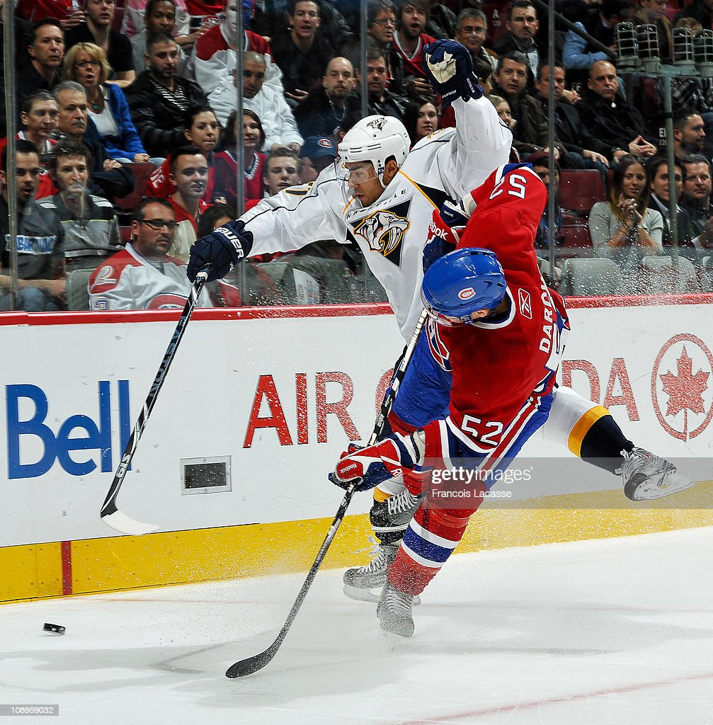 Mathieu Darche of the Montreal Canadiens collides with Francis Bouillon the Nashville Predators during the NHL game on November 18 2010 at the Bell...