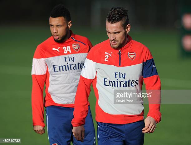 Mathieu Debuchy and Francis Coquelin of Arsenal during the Arsenal Training Session at London Colney on December 20 2014 in St Albans England