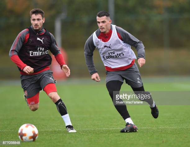 Mathieu Debuchy and Granit Xhaka of Arsenal during a training session at London Colney on November 21 2017 in St Albans England