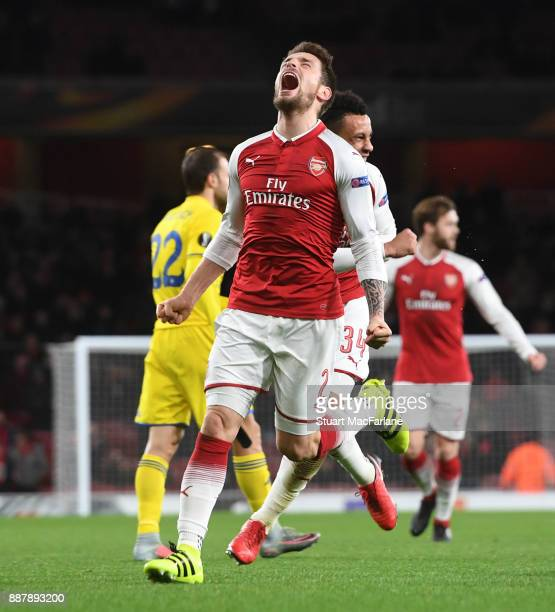 Mathieu Debuchy celebrates scoring for Arsenal during the UEFA Europa League group H match between Arsenal FC and BATE Borisov at Emirates Stadium on...