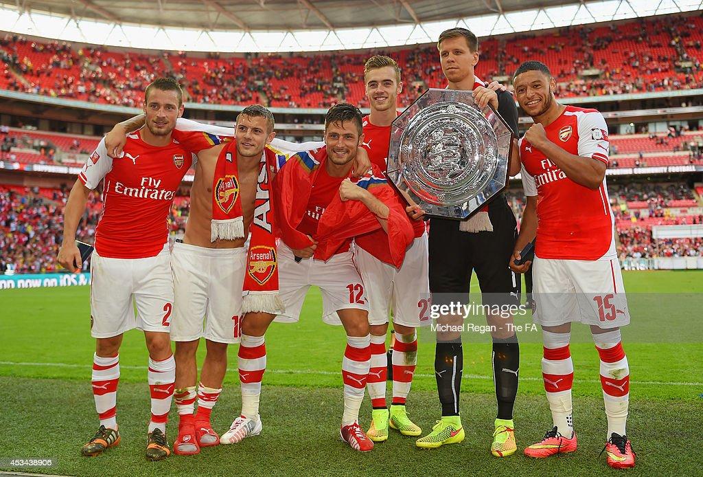 Mathieu Debuchy Jack Wilshere Olivier Giroud Calum Chambers Wojciech Szczesny and Alex OxladeChamberlain of Arsenal pose with the FA Community Shield...