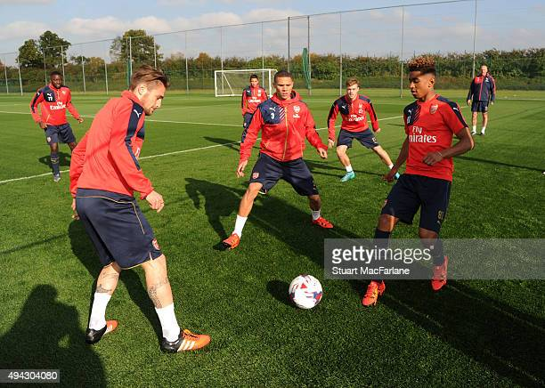 Mathieu Debuchy Kieran Gibbs and Riess Nelson of Arsenal during a training session at London Colney on October 26 2015 in St Albans England