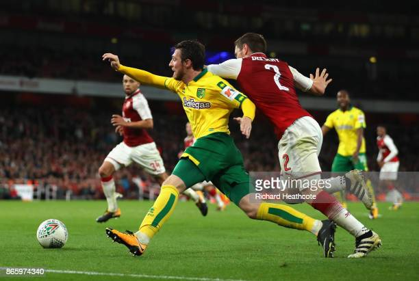 Mathieu Debuchy of Arsenal brings down James Husband of Norwich City in the box during the Carabao Cup Fourth Round match between Arsenal and Norwich...
