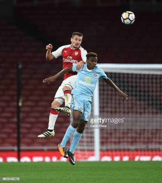 Mathieu Debuchy of Arsenal heads the ball under pressure from Joel Asoro of Sunderland during the Premier League 2 match between Arsenal and...