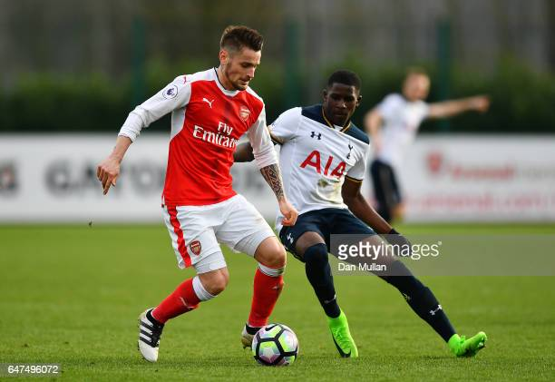 Mathieu Debuchy of Arsenal holds off Shilow Tracey of Tottenham Hotspur during the Premier League 2 match between Arsenal and Tottenham Hotspur at...