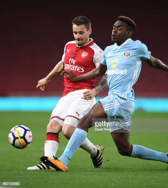 Mathieu Debuchy of Arsenal is challenged by Joel Asoro of Sunderland during the Premier League 2 match between Arsenal and Sunderland at Emirates...