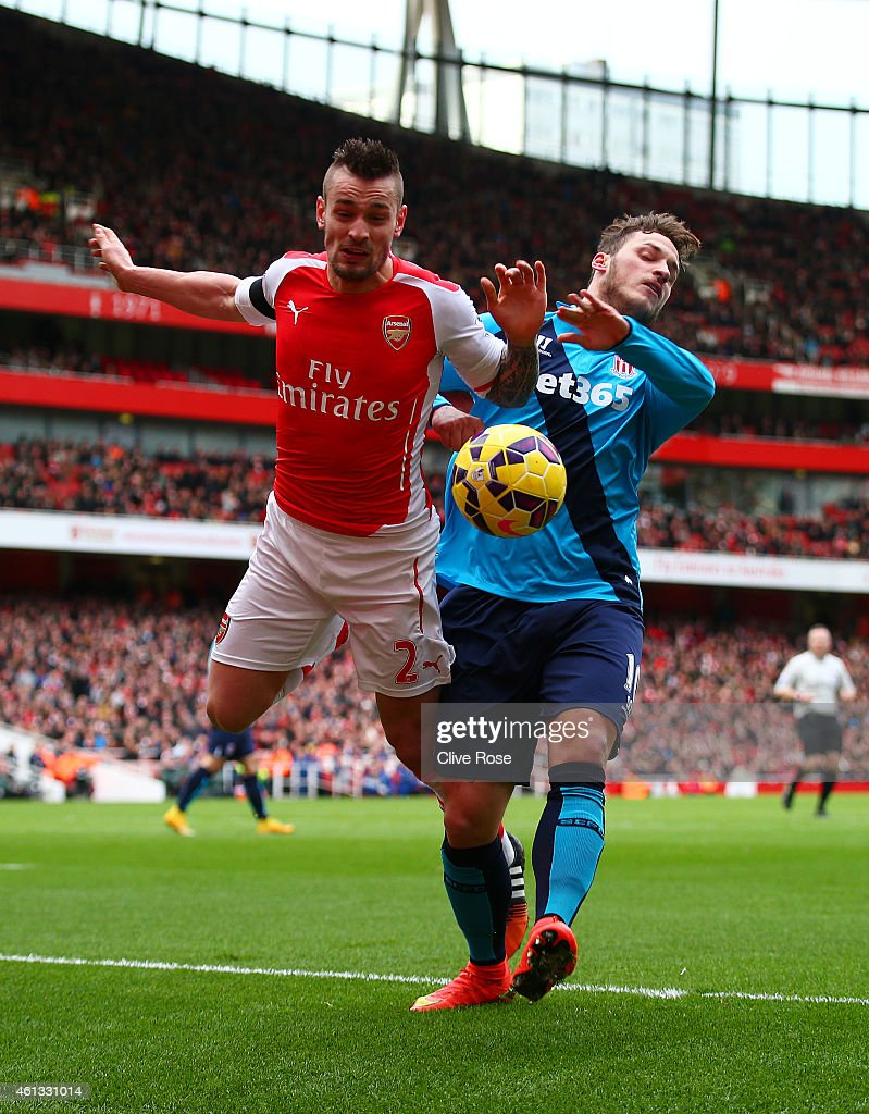 <a gi-track='captionPersonalityLinkClicked' href=/galleries/search?phrase=Mathieu+Debuchy&family=editorial&specificpeople=729104 ng-click='$event.stopPropagation()'>Mathieu Debuchy</a> of Arsenal is challenged by <a gi-track='captionPersonalityLinkClicked' href=/galleries/search?phrase=Marko+Arnautovic&family=editorial&specificpeople=5567995 ng-click='$event.stopPropagation()'>Marko Arnautovic</a> of Stoke City and subsequently picks up an injury during the Barclays Premier League match between Arsenal and Stoke City at Emirates Stadium on January 11, 2015 in London, England.