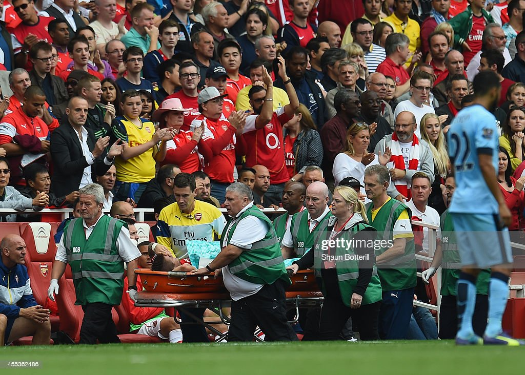 Mathieu Debuchy of Arsenal is stretchered off during the Barclays Premier League match between Arsenal and Manchester City at Emirates Stadium on...