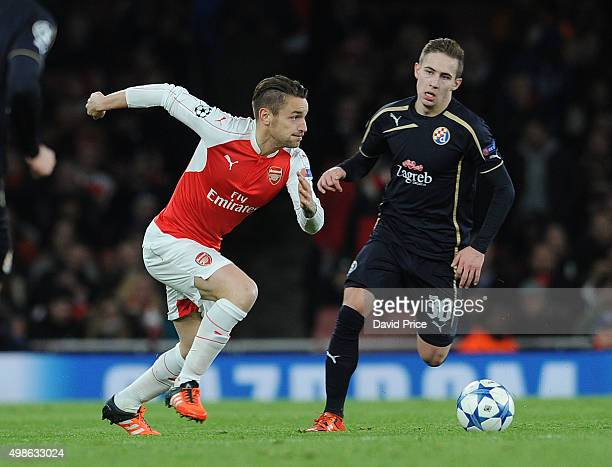 Mathieu Debuchy of Arsenal takes on Marko Rog of Zagreb during the match between Arsenal and Dinamo Zagreb in the UEFA Champions League on November...