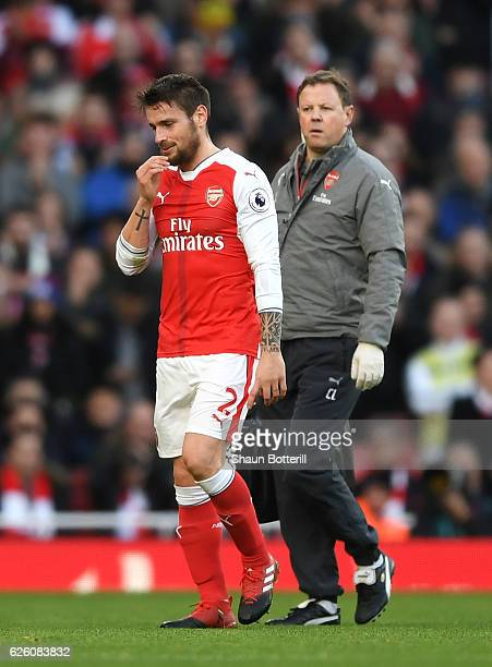 Mathieu Debuchy of Arsenal walks off the pitch injured during the Premier League match between Arsenal and AFC Bournemouth at Emirates Stadium on...